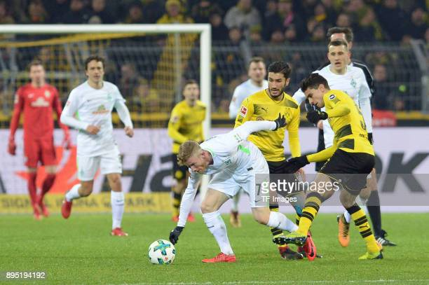 Florian Kainz of Bremen and Marc Bartra Aregall of Dortmund battle for the ball during the Bundesliga match between Borussia Dortmund and SV Werder...