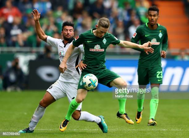 Florian Kainz of Bremen and marco Terrazzoni of Freiburg battle for the ball during the Bundesliga match between SV Werder Bremen and SportClub...