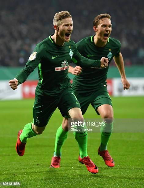 Florian Kainz of Bremen celebrates scoring his goal during the DFB Cup match between Werder Bremen and SC Freiburg at Weserstadion on December 20...
