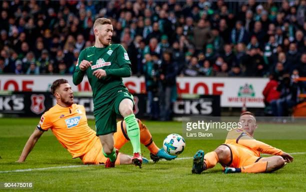 Florian Kainz of Bremen is blocked by Pavel Kaderabek of Hoffenheim during the Bundesliga match between SV Werder Bremen and TSG 1899 Hoffenheim at...