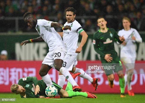 Florian Kainz of Bremen is challenged by Salif Sane of Hannover during the Bundesliga match between SV Werder Bremen and Hannover 96 at Weserstadion...