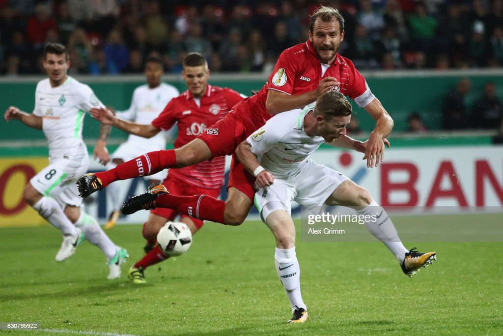 Florian Kainz (front) of Bremen is challenged by Sebastian Neumann of Wuerzburg during the DFB Cup first round match between Wuerzburger Kickers and SV Werder Bremen at Sparda-Bank-Hessen-Stadion on August 12, 2017 in Offenbach, Germany.