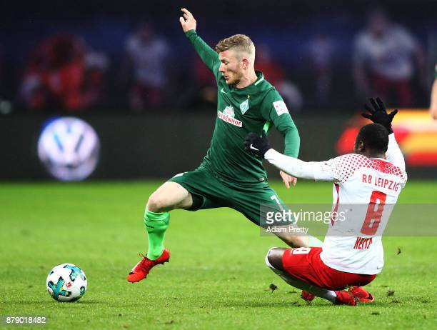 Florian Kainz of Werder Bremen is tackled by Naby Keita of RB Leipzig during the Bundesliga match between RB Leipzig and SV Werder Bremen at Red Bull...
