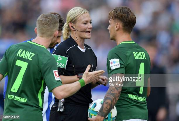 Florian Kainz of Werder Bremen referee Bibiana Steinhaus and Robert Bauer of Werder Bremen during the game between Hertha BSC and Werder Bremen on...