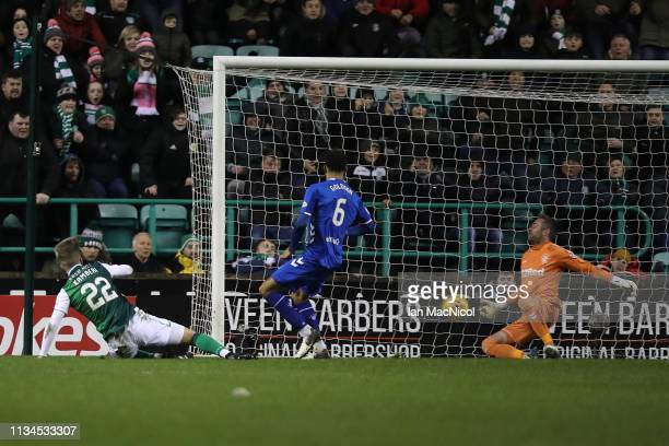 Florian Kamberi of Hibernian equalises despite the efforts of goalkeeper Allan McGregor of Rangers during the Ladbrokes Premiership match between...