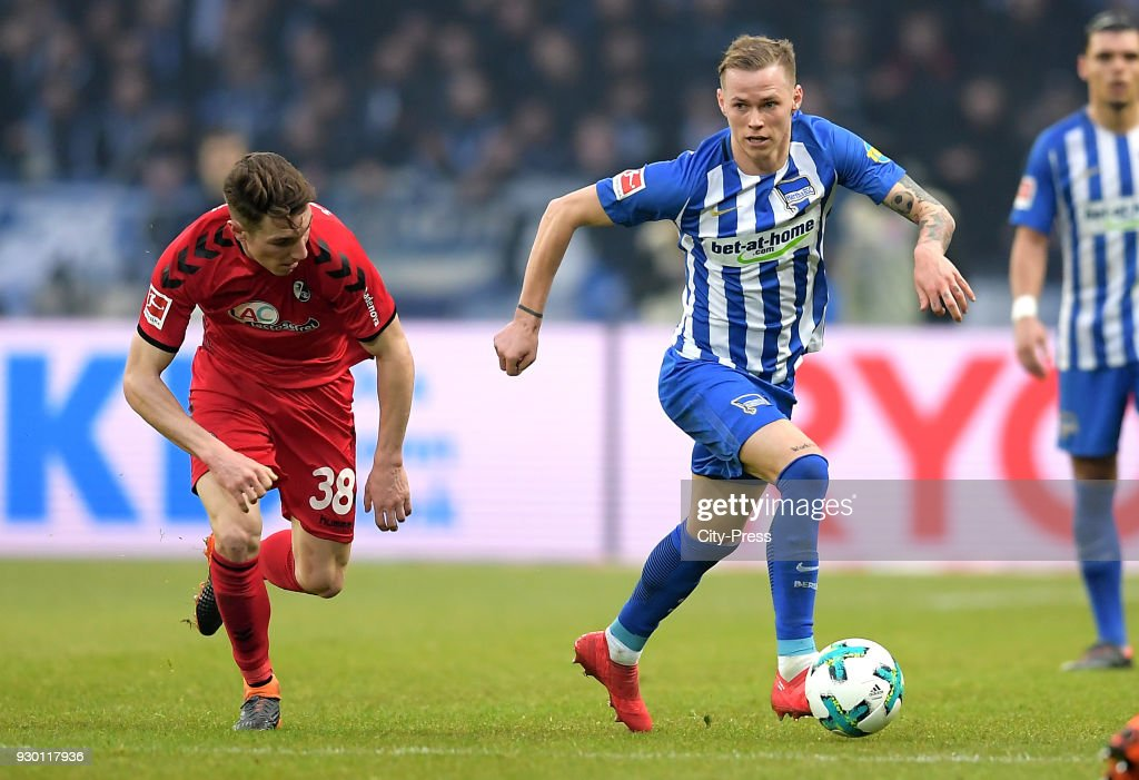 Florian Kath of SC Freiburg and Ondrej Duda of Hertha BSC during the Bundesliga match between Hertha BSC and SC Freiburg at Olympiastadion on March 10, 2018 in Berlin, Germany.