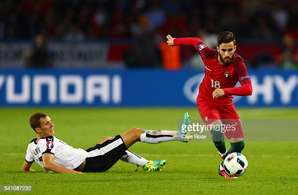 Florian Klein of Austria goes to ground as Rafa Silva of Portugal runs past during the UEFA EURO 2016 Group F match between Portugal and Austria at...