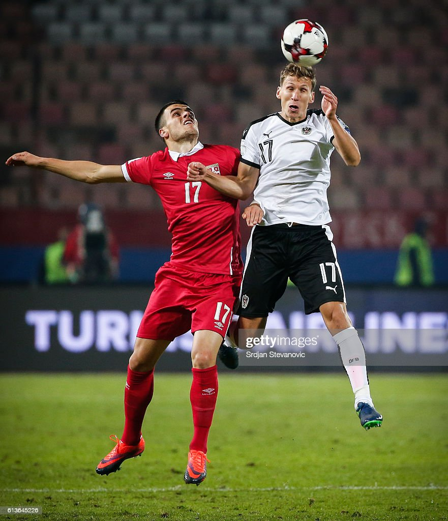 Florian Klein (C) of Austria jump for the ball against Filip Kostic (R) and Stefan Mitrovic (R) of Serbia during the FIFA 2018 World Cup Qualifier between Serbia and Austria at stadium Rajko Mitic on October 9, 2016 in Belgrade, .