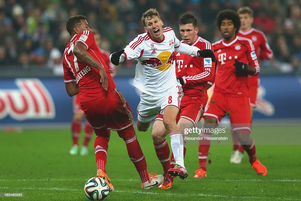 Florian Klein (2nd L) of Salzburg battle for the ball with Jerome Boateng (L) of Bayern Muenchen and his team mates Pierre Emil Hojbjerg (2nd R) and Dante (R) during the friendly match between Red Bull Salzburg and FC Bayern Muenchen at Red Bull Arena on January 18, 2014 in Salzburg, Austria.