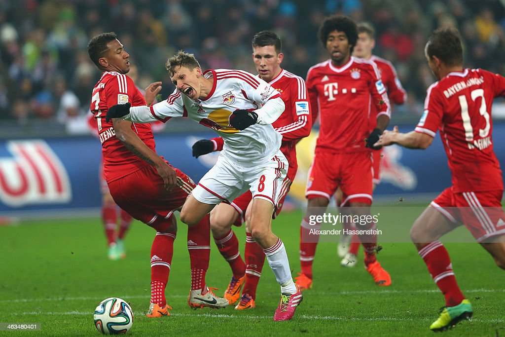 Florian Klein (2nd L) of Salzburg battle for the ball with Jerome Boateng (L) of Bayern Muenchen and his team mates Pierre Emil Hojbjerg (3rd R), Dante (2nd R) and Rafinha (R) during the friendly match between Red Bull Salzburg and FC Bayern Muenchen at Red Bull Arena on January 18, 2014 in Salzburg, Austria.