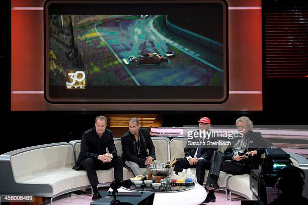 Florian Koenig Kai Ebel Niki Lauda and Thomas Gottschalk watch the accident scene of the film 'Rush' during the taping of the anniversary show '30...