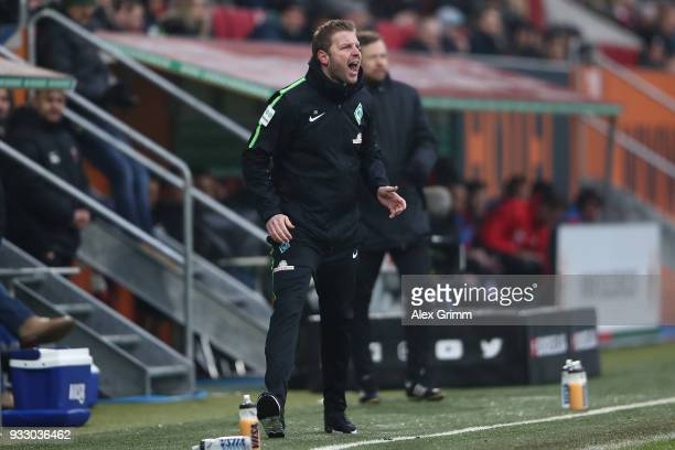 Florian Kohfeldt coach of Bremen scream on the sideline during the Bundesliga match between FC Augsburg and SV Werder Bremen at WWKArena on March 17...