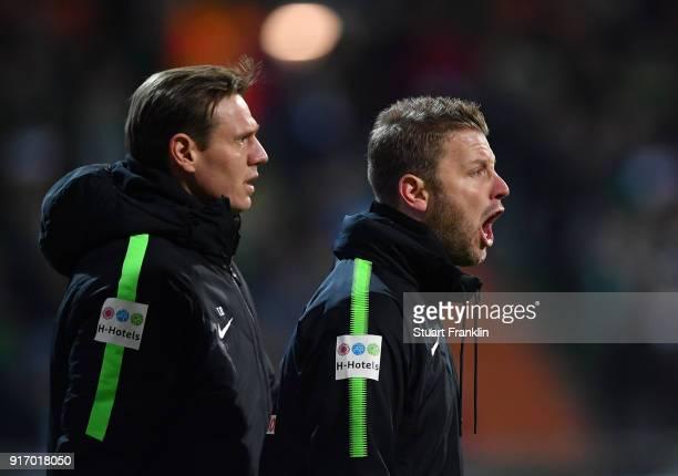 Florian Kohfeldt head coach of Bremen and his assistant Tim Borrowski look on during the Bundesliga match between SV Werder Bremen and VfL Wolfsburg...