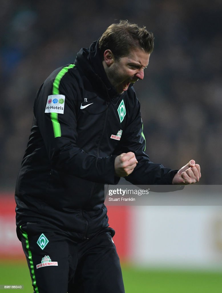 Florian Kohfeldt, head coach of Bremen celebrates at the final whistle during the DFB Cup match between Werder Bremen and SC Freiburg at Weserstadion on December 20, 2017 in Bremen, Germany.