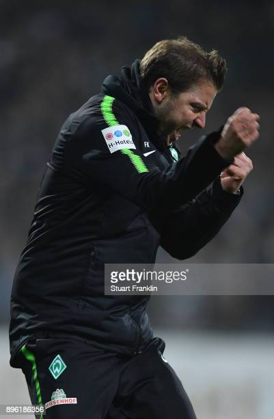 Florian Kohfeldt, head coach of Bremen celebrates at the final whistle during the DFB Cup match between Werder Bremen and SC Freiburg at Weserstadion...