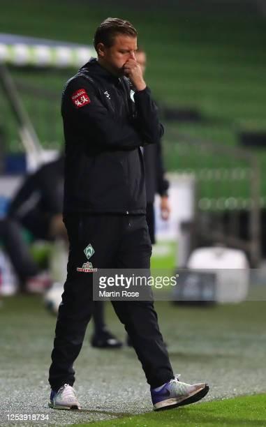 Florian Kohfeldt, head coach of Bremen ponders during the Bundesliga playoff first leg match between Werder Bremen and 1. FC Heidenheim at Wohninvest...