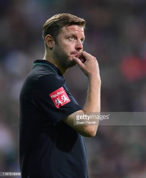 Florian Kohfeldt, head coach of Bremen ponders during the DFB Cup first round match between Atlas Delmenhorst and SV Werder Bremen at Wohninvest...