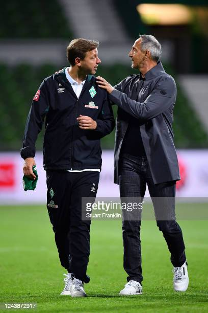 Florian Kohfeldt, Head Coach of SV Werder Bremen is consoled by Adolf Hutter, Head Coach of Eintracht Frankfurt after the Bundesliga match between SV...