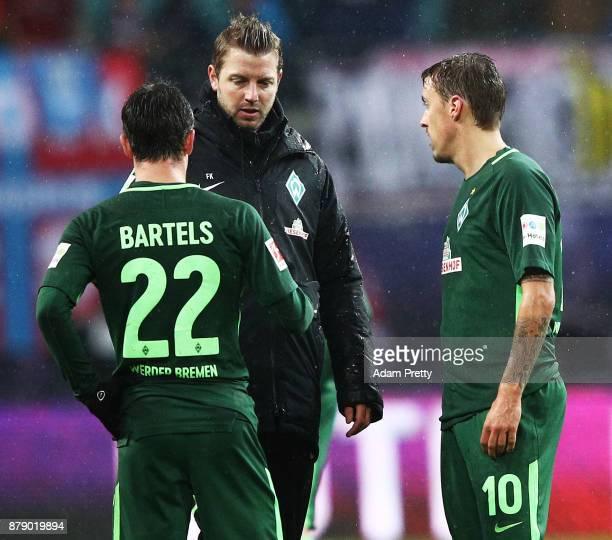 Florian Kohfeldt head coach of Werder Bremen and Max Kruse of Werder Bremen is dejected after losing the Bundesliga match between RB Leipzig and SV...