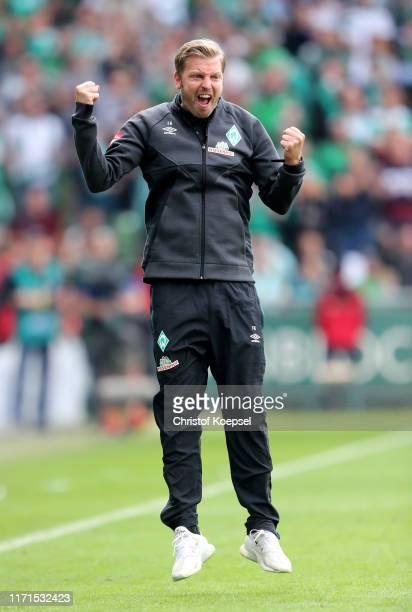 Florian Kohfeldt, Manager of Werder Bremen celebrates at full-time during the Bundesliga match between SV Werder Bremen and FC Augsburg at Wohninvest...