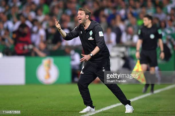 Florian Kohfeldt Manager of Werder Bremen reacts during the DFB Cup semi final match between Werder Bremen and FC Bayern Muenchen at Weserstadion on...