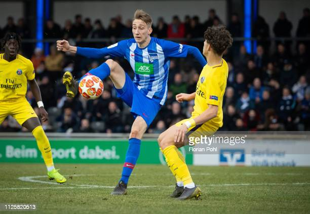 Florian Krebs of Hertha BSC U19 and Adil Aouchiche of Paris St Germain during the game between Hertha BSC U19 against Paris St Germain U19 at the...
