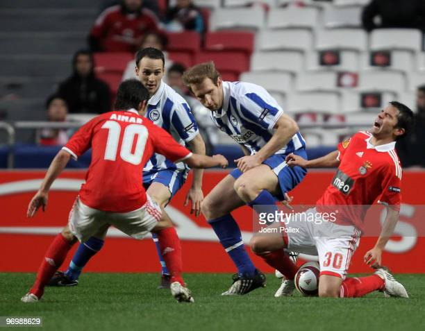 Florian Kringe of Berlin battles for the ball with Javier Saviola of Benfica during the UEFA Europa League knockout round second leg match between SL...