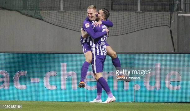 Florian Krueger celebrates the opening goal with Pascal Testroet of Aue during the Second Bundesliga match between FC Erzgebirge Aue and Karlsruher...