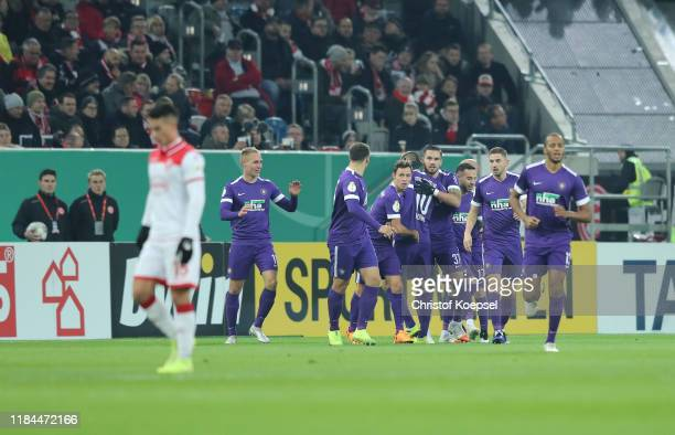 Florian Kruger of Erzgebirge Aue celebrates scoring his team's first goal during the DFB Cup second round match between Fortuna Duesseldorf and...