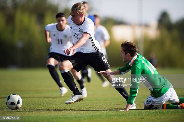 Florian Kruger of Germany conducts the ball past Cian Flanagan of Ireland during the U18 international friendly match between Ireland and Germany on...