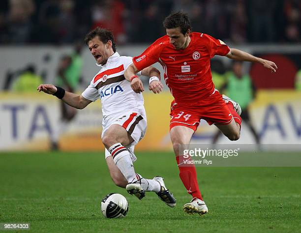 Florian Lechner of St. Pauli and Martin Harnik of Fortuna battle for the ball during the Second Bundesliga match between Fortuna Duesseldorf and FC...