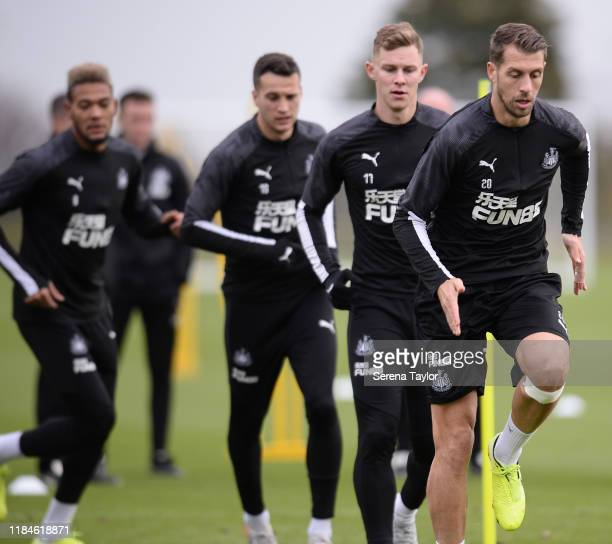 Florian Lejeune leads the warm up line during the Newcastle United Training Session at the Newcastle United Training Centre on October 31, 2019 in...