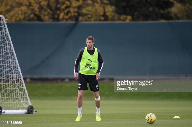 Florian Lejeune looks to pass the ball during the Newcastle United Training Session at the Newcastle United Training Centre on October 31, 2019 in...