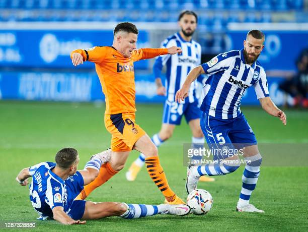 Florian Lejeune of Deportivo Alaves duels for the ball with Kevin Gameiro of Valencia CF during the LaLiga Santander match between Alaves and...