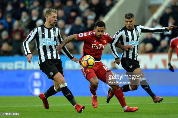 Florian Lejeune of Newcastle United and Deandre Yedlin of Newcastle United put pressure on Andre Gray of Watford during the Premier League match...
