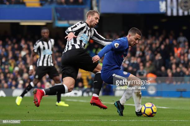Florian Lejeune of Newcastle United and Eden Hazard of Chelsea during the Premier League match between Chelsea and Newcastle United at Stamford...