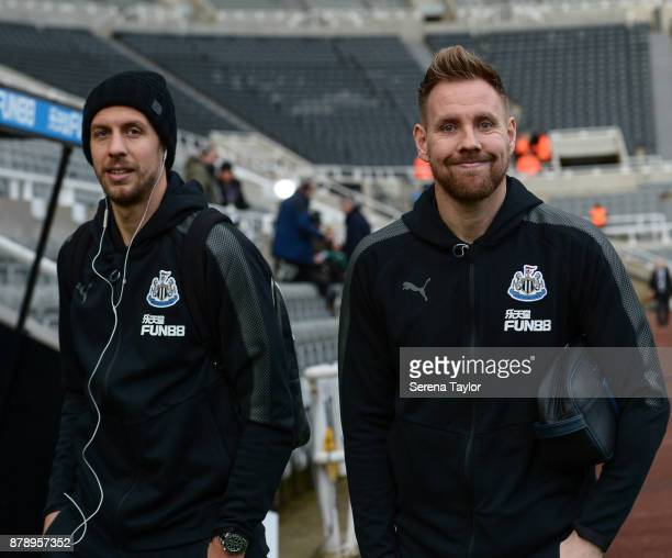 Florian Lejeune of Newcastle United and Goalkeeper Rob Elliot arrives for the Premier League match between Newcastle United and Watford FC at...