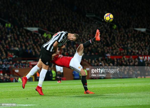 Florian Lejeune of Newcastle United and Juan Mata of Manchester United in action during the Premier League match between Manchester United and...