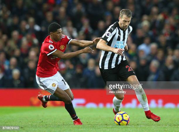 Florian Lejeune of Newcastle United and Marcus Rashford of Manchester United in action during the Premier League match between Manchester United and...