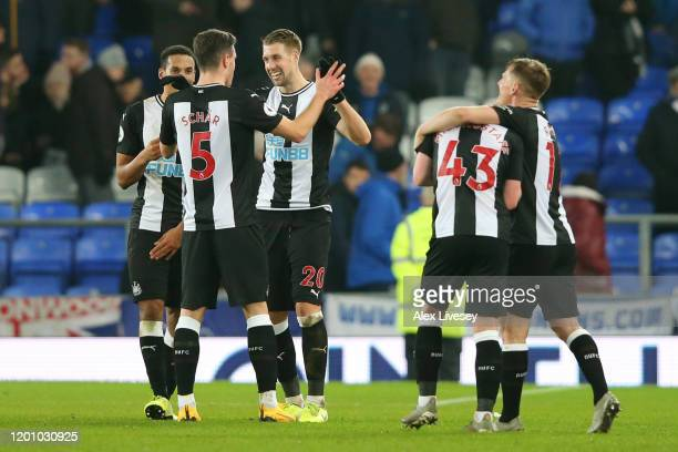 Florian Lejeune of Newcastle United celebrates with Fabian Schar after scoring his team's second goal during the Premier League match between Everton...