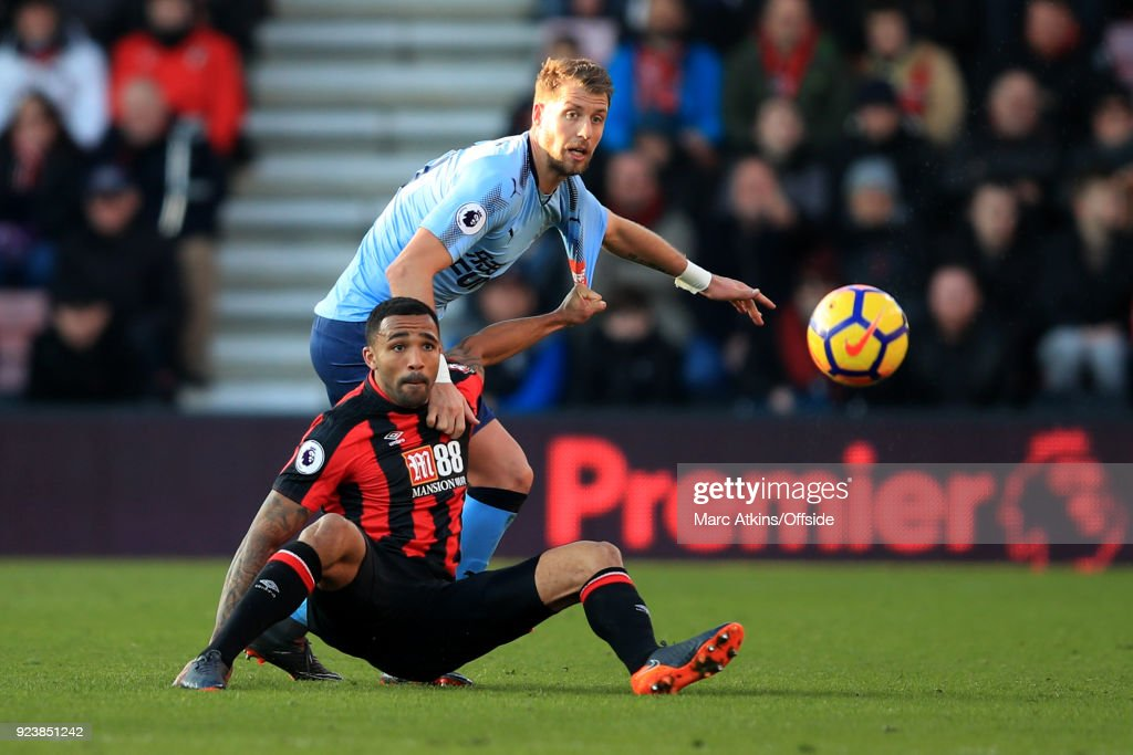 Florian Lejeune of Newcastle United in action with Callum Wilson of AFC Bournemouth during the Premier League match between AFC Bournemouth and Newcastle United at Vitality Stadium on February 24, 2018 in Bournemouth, England.