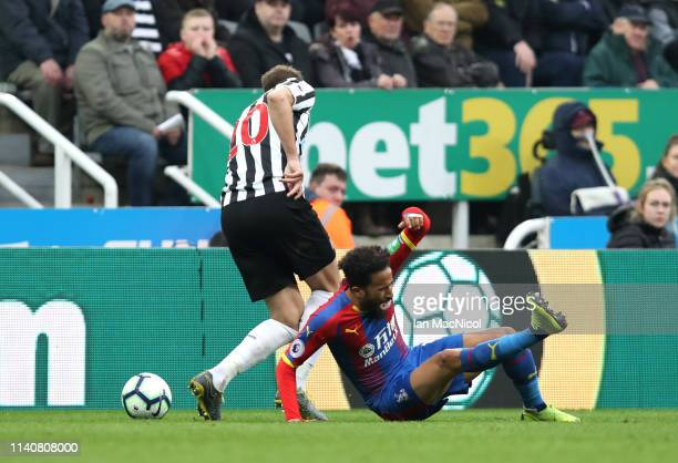 Florian Lejeune of Newcastle United is fouled by Andros Townsend of Crystal Palace during the Premier League match between Newcastle United and...