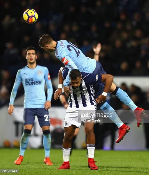 Florian Lejeune of Newcastle United outjumps Jose Salomon Rondon of West Bromwich Albion during the Premier League match between West Bromwich Albion...