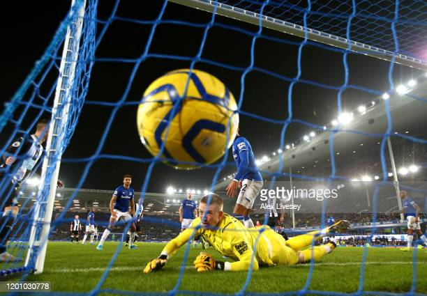 Florian Lejeune of Newcastle United scores his team's first goal during the Premier League match between Everton FC and Newcastle United at Goodison...