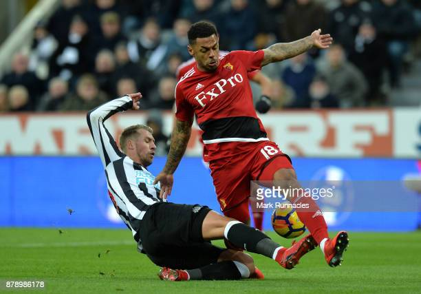 Florian Lejeune of Newcastle United tackles Andre Gray of Watford during the Premier League match between Newcastle United and Watford at St James...