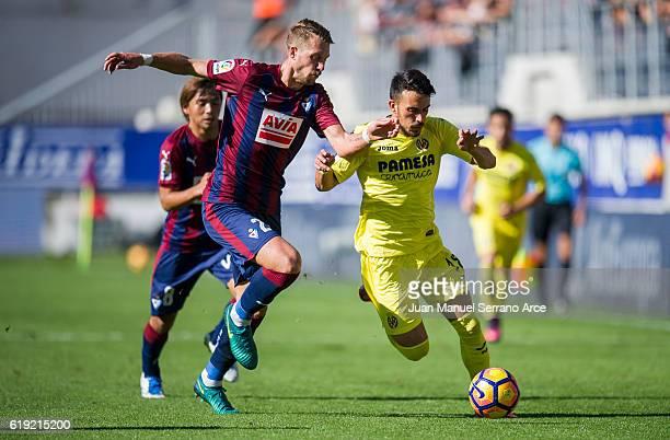 Florian Lejeune of SD Eibar duels for the ball with Nicola Sansone of Villarreal CF during the La Liga match between SD Eibar and Villarreal CF at...
