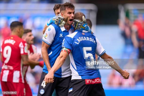 Florian Lejeune, Victor Laguardia and Fernando Pacheco of Deportivo Alaves celebrate victory after the La Liga Santander match between Deportivo...