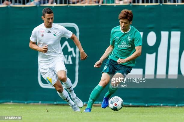 Florian Mader of WSG Wattens and Yuya Osako of SV Werder Bremen battle for the ball during the friendly match between SV Werder Bremen and WSG...