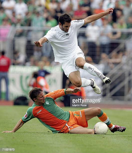 Florian Marange of Bordeaux and Jurica Vranjes of Bremen fight for the ball during the friendly match between Girondins Bordeaux and Werder Bremen at...