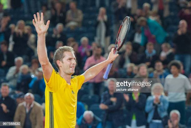 Florian Mayer from Germany celebrates his victory over Schwartzman from Argentina in the men's singles at the Tennis ATPTour German Open in Hamburg...